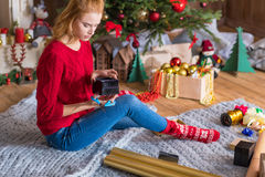 Girl wrapping gift box Royalty Free Stock Images