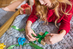 Girl wrapping gift box Royalty Free Stock Image