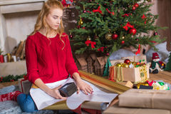 Girl wrapping gift box Stock Image