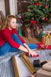 Girl wrapping gift boxes Royalty Free Stock Image