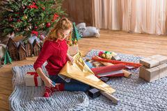Girl wrapping gift boxes Stock Photography