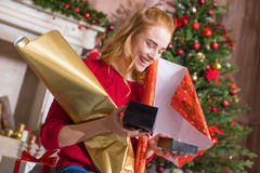 Girl wrapping gift boxes Stock Image