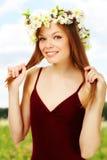 Girl in wreath Stock Photos