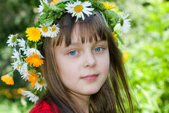 The girl with a wreath. The girl with blue eyes in a wreath Stock Images