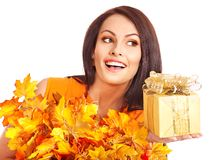 Girl with a wreath of autumn leaves on the head. Royalty Free Stock Images