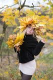 Girl in a wreath of autumn leaves Royalty Free Stock Photography