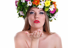 Girl in wreath and blowing in the hand Royalty Free Stock Images