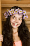 Girl in a wreath from camomiles Royalty Free Stock Images