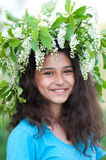 Girl with a wreath of cherry blossoms on her head Stock Photo