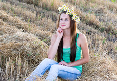 Girl with  wreath of daisies in a  field Stock Image