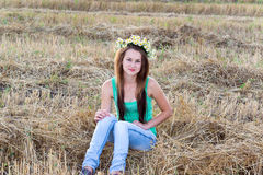 Girl with  wreath of daisies in a  field Stock Photography