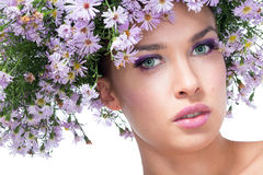 Girl in a wreath daisies Stock Photo