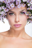 Girl in a wreath daisies Royalty Free Stock Image