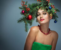 Girl in a wreath of fir branches Royalty Free Stock Images