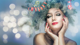 Girl in a wreath of fir branches Royalty Free Stock Image