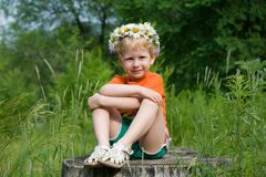Girl in a wreath of flowers Stock Photos