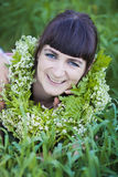 Girl in wreath of flowers Royalty Free Stock Photo
