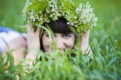 Girl in wreath of flowers Royalty Free Stock Photography