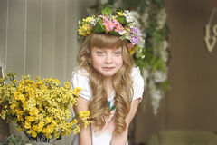 Girl in a wreath of flowers Royalty Free Stock Images