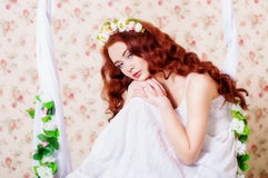 Girl in a wreath of flowers Stock Photo