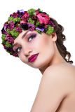 Girl in a wreath of flowers Stock Photography