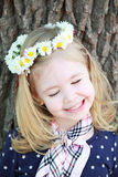 Girl with close eyes and a wreath of flowers on her head Royalty Free Stock Image