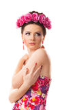 Girl with a wreath of flowers on her head on white background Stock Photo