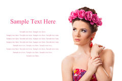 Girl with a wreath of flowers on her head on white background Royalty Free Stock Image