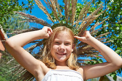 Girl in a wreath of grass with spikelets Stock Photography