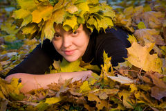 Girl in wreath of leaves Royalty Free Stock Image