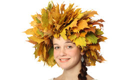 Girl in wreath of leaves Stock Photo