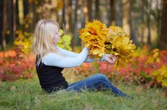 Girl with a wreath of leaves Stock Photos