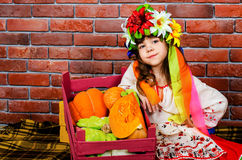 Girl in a wreath. Little girl in national costume Royalty Free Stock Photos