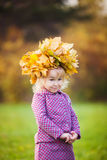 Girl with a wreath of maple leaves on head Royalty Free Stock Photography