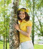Girl in wreath  near birch Stock Photography