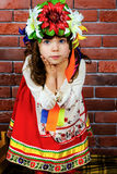 Girl in a wreath. Surprised girl in national costume Stock Image