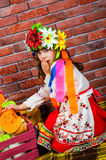 Girl in a wreath. Surprised girl in national costume Royalty Free Stock Images