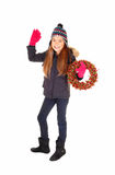 Girl with wreath waiving. Stock Image