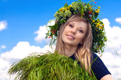 Girl in a wreath which reaps a crop in Royalty Free Stock Images