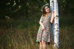 Girl with a wreath of wild flowers Stock Photo