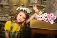GIRL WITH wreaths of flowers on the head. And a bunch of flowers Royalty Free Stock Photo