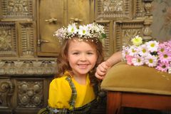 GIRL WITH wreaths of flowers on the head. And a bunch of flowers Royalty Free Stock Photos