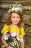 GIRL WITH wreaths of flowers on the head. And a bunch of flowers Royalty Free Stock Photography