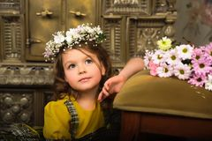 GIRL WITH wreaths of flowers on the head. And a bunch of flowers Stock Photos