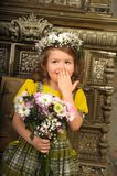 GIRL WITH wreaths of flowers on the head. And a bunch of flowers Stock Images