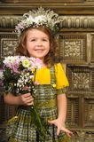 GIRL WITH wreaths of flowers on the head. And a bunch of flowers Stock Photo