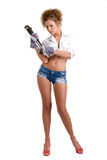 Girl with wrench and glooves Stock Photography