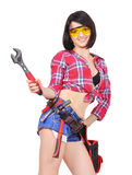 Girl with wrench Stock Images