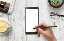 Girl write with pen on isolated white mobile phone display royalty free stock photo