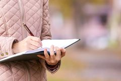Girl write poem. Business concept idea.  stock photography